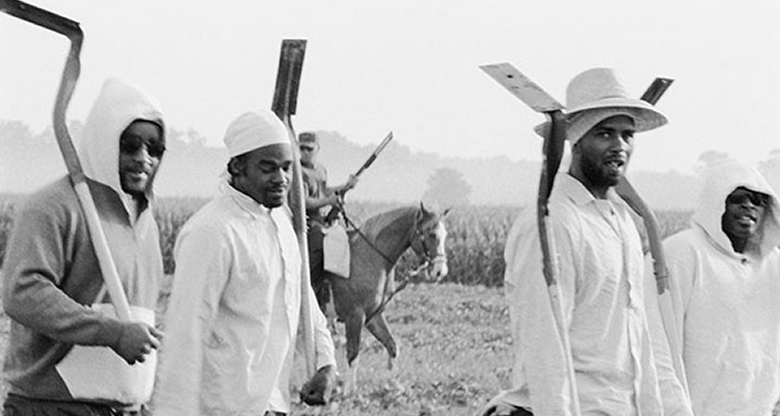 Chandra McCormick. Men Going to Work in the Fields of Angola, 2004. Archival pigment print. Courtesy of the artist. © Chandra McCormick